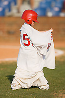 A young fan tries to put on a Johnson City Cardinals uniform during an on-field contest during the Appalachian League game between the Elizabethton Twins and the Johnson City Cardinals at Howard Johnson Field July 3, 2010, in Johnson City, Tennessee.  Photo by Brian Westerholt / Four Seam Images