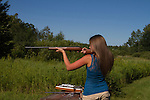 Young woman shooting a Marlin .22 rifle