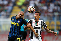 Calcio, Serie A: Inter vs Juventus. Milano, stadio San Siro, 18 settembre 2016.<br /> Inter's Miranda, left, and Juventus' Mario Mandzukic jump for the ball during the Italian Serie A football match between FC Inter and Juventus at Milan's San Siro stadium, 18 September 2016.<br /> UPDATE IMAGES PRESS/Isabella Bonotto