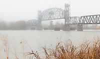 The railroad bridge over the Arkansas River at Fort Smith Arkansas on a foggy fall moring.