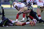 Seattle Seahawks linebacker Bobby Wagner (54) brings down San Francisco 49ers wide receiver Quinton Patton (11) at CenturyLink Field in Seattle, Washington on November 22, 2015.  The Seahawks beat the 49ers 29-13.   ©2015. Jim Bryant Photo. All RIghts Reserved.