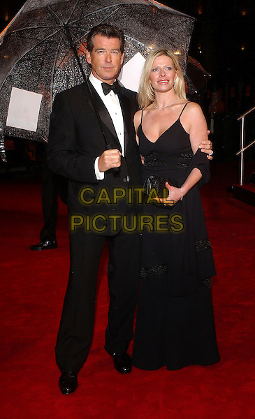 PIERCE BROSNAN & CHARLOTTE BROSNAN.The 2006 Orange British Academy Film Awards, Odeon Leicester Square, London, UK..February 19th, 2006.Ref: BEL.half length black tuxedo dress adopted daughter umbrella bafta baftas.www.capitalpictures.com.sales@capitalpictures.com.© Capital Pictures.