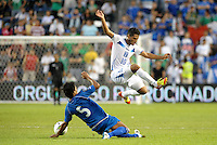 Alexander Lopez (10) Honduras jumps over the tackle from Alexander Mendoza (5) El Salvador... Honduras defeated El Salvador 3-2 after extra time to go through to the final at LIVESTRONG Sporting Park, Kansas City, Kansas.