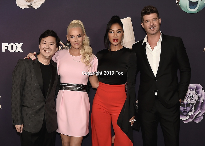 """BEVERLY HILLS  - SEPTEMBER 10:  Ken Jeong, Jenny McCarthy, Nicole Scherzinger and Robin Thicke attend the season two premiere event for FOX's """"The Masked Singer"""" at The Bazaar at the SLS Beverly Hills on September 10, 2019 in Beverly Hills, California. (Photo by Scott Kirkland/FOX/PictureGroup)"""