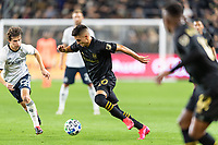 LOS ANGELES, CA - MARCH 08: Eduard Atuesta #20 of LAFC Brenden Aaronson #22 of Philadelphia Union during a game between Philadelphia Union and Los Angeles FC at Banc of California Stadium on March 08, 2020 in Los Angeles, California.
