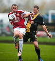 Culter's George McBain and Stephen Tulloch challenge for the ball.