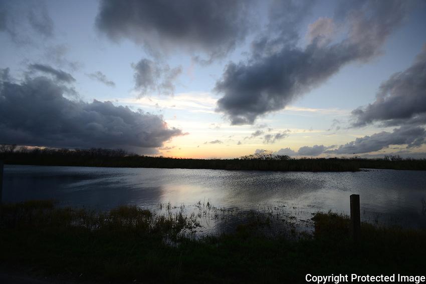 Storm clouds gathering over the Everglades. Photographed at Arthur Marshall Loxahatchee<br /> Wildlife Refuge, Boynton Beach, Florida.