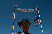 Jesse Halsell, 79,who traveled from California, stands in front of a sign that reads, &quot;Liberty Freedom, For God We Stand.&quot; The sign was erected by Bundy supporters on the side of the road near the Cliven Bundy ranch in Bunkerville, Nevada, USA.<br />