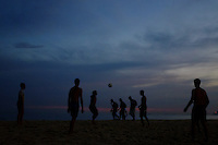 A view of people playing football on Ipanema beach in Rio de Janiero at sunset
