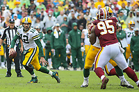 Landover, MD - September 23, 2018: Green Bay Packers quarterback Aaron Rodgers (12) scrambles during the  game between Green Bay Packers and Washington Redskins at FedEx Field in Landover, MD.   (Photo by Elliott Brown/Media Images International)