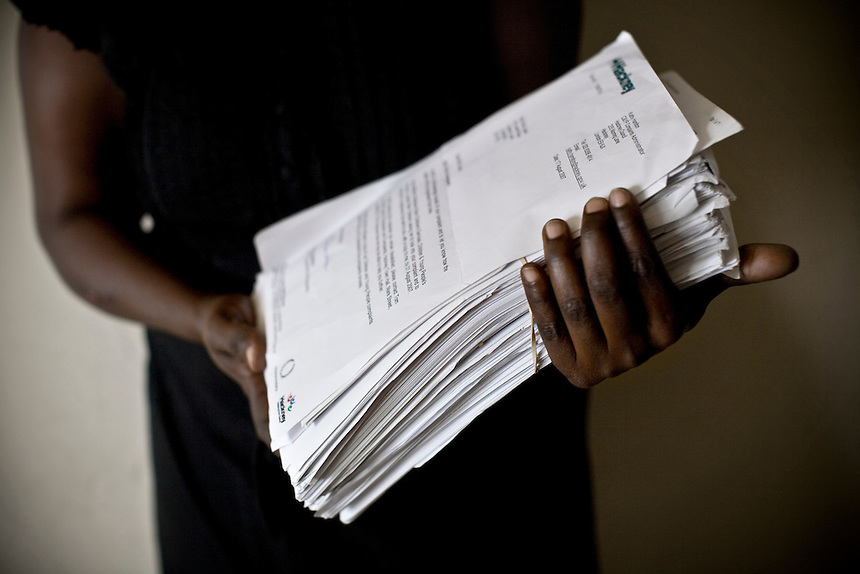 Vicky Laker holds a pile of correspondance dating only nine months between her and Hackney Council in regard to her stay in Alexandra Court Temporary Hostel. The correspondance includes complaints from Miss Laker over the state of her £350 per week accomodation as well as threats of eviction from Hackney Council.