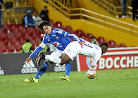 BOGOTA - COLOMBIA - 21 - 07 - 2016: Rafael Robayo (Izq.) jugador de Millonarios disputa el balón con Jhon Rendon (Der.) jugador de Once Caldas, durante partido adelantado de la fecha 11 entre Millonarios y Once Caldas, de la Liga Aguila II-2016, jugado en el estadio Nemesio Camacho El Campin de la ciudad de Bogota.  / Rafael Robayo (L) player of Millonarios vies for the ball with Jhon Rendon (R) player of Once Caldas, during an advance match between Millonarios and Once Caldas, for the date 11 of the Liga Aguila II-2016 at the Nemesio Camacho El Campin Stadium in Bogota city, Photo: VizzorImage / Luis Ramirez / Staff.