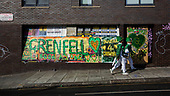 London, UK. 28 August 2017. Notting Hill Carnival celebrations and parade on Bank Holiday Monday. The festival attacts usually over 1 million visits and this year it remembers the victims of the Grenfell Tower fire.
