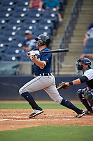 Lakeland Flying Tigers first baseman Blaise Salter (21) follows through on a swing in front of catcher Keith Skinner (10) during a game against the Tampa Tarpons on April 8, 2018 at George M. Steinbrenner Field in Tampa, Florida.  Lakeland defeated Tampa 3-1.  (Mike Janes/Four Seam Images)