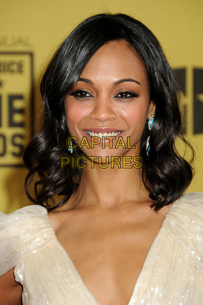 ZOE SALDANA .15th Annual Critics' Choice Movie Awards - Arrivals held at the Hollywood Palladium, Hollywood, California, USA, 15th January 2010..portrait headshot cream shiny beige turquoise dangly earrings smiling .CAP/ADM/BP.©Byron Purvis/Admedia/Capital Pictures
