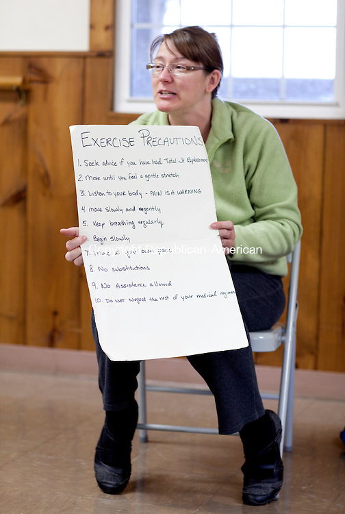 GOSHEN, CT-25 April 2012-042512BF04-- Jill Maeder, a physical therapist and certified instructor, goes through a list of precautions during the  Arthritis Foundation Exercise Program sponsored by the Goshen Recreation Department. During the six-week program, participants will go through a series of gentle movements and activities designed to increase mobility and range of motion. The low-impact class is suitable for every fitness level and can be taken either sitting down or standing. Bob Falcetti Republican-American