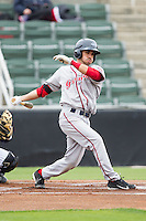 Carlos Asuaje (20) of the Greenville Drive follows through on his swing against the Kannapolis Intimidators at CMC-Northeast Stadium on April 6, 2014 in Kannapolis, North Carolina.  The Intimidators defeated the Drive 8-5.  (Brian Westerholt/Four Seam Images)