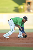 Gwinnett Stripers third baseman Pedro Florimon (18) fields a ground ball against the Scranton/Wilkes-Barre RailRiders at BB&T BallPark on August 16, 2019 in Lawrenceville, Georgia. The Stripers defeated the RailRiders 5-2. (Brian Westerholt/Four Seam Images)