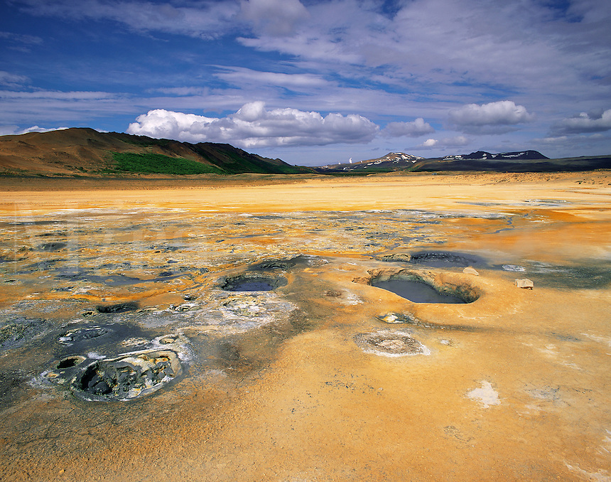 Geothermal landscape at Myvatn, northern Iceland, with bright yellow sulphur-stained earth, boiling mud pools and fumaroles etc