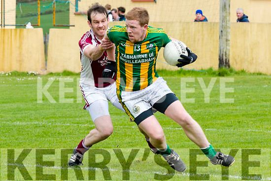 Lios Póil Matthew Griffin in possession of the ball tackled by Cromane Eoghan Walsh during the Junior (Novice) Championship match at Lispole GAA Grounds on Sunday afternoon.