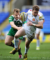 Will Chudley of Exeter Chiefs takes on the London Irish defence. Aviva Premiership match, between London Irish and Exeter Chiefs on February 21, 2016 at the Madejski Stadium in Reading, England. Photo by: Patrick Khachfe / JMP