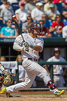 Mississippi State designated hitter Trey Porter (32) follows through on his swing during Game 11 of the 2013 Men's College World Series against the Oregon State Beavers on June 21, 2013 at TD Ameritrade Park in Omaha, Nebraska. The Bulldogs defeated the Beavers 4-1, to reach the CWS Final and eliminating Oregon State from the tournament. (Andrew Woolley/Four Seam Images)