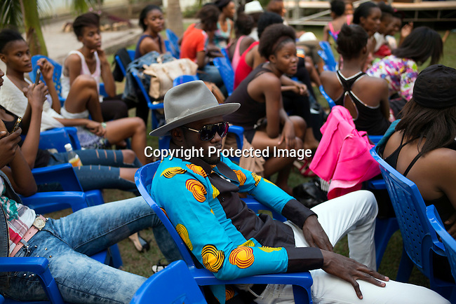 KINSHASA, DRC - KINSHASA, DRC - JULY 23: Models wait for rehearsals at Kinshasa Fashion Week on July 23, 2015, at the boxing gym at Shark club in Kinshasa, DRC. Local and invited foreign-based designers showed their collections during the 2015 edition of Kinshasa Fashion week. (Photo by Per-Anders Pettersson)