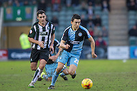 Luke O'Nien gets past Carl McHugh of Plymouth Argyle during the Sky Bet League 2 match between Plymouth Argyle and Wycombe Wanderers at Home Park, Plymouth, England on 30 January 2016. Photo by Mark  Hawkins / PRiME Media Images.