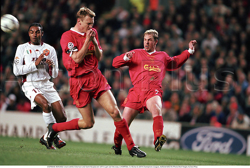 STEPHANE HENCHOZ clears while Emerson and Sami Hyypia are left to get out the way, LIVERPOOL 2 v Roma 0, UEFA Champions League, Anfield 020319. Photo:Neil Tingle/Action Plus...2002.Soccer.Football.premiership premier league.club