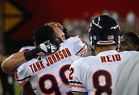 Oct. 16, 2006; Glendale, AZ, USA; Chicago Bears linebacker (54) Brian Urlacher celebrates with defensive tackle (99) Tank Johnson after defeating the Arizona Cardinals at University of Phoenix Stadium in Glendale, AZ. Mandatory Credit: Mark J. Rebilas