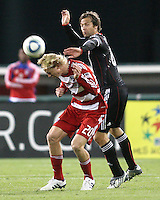 Carey Talley #8 of D.C. United comes up behind Brek Shea #20 of F.C. Dallas during a US Open Cup match on April 28 2010, at RFK Stadium in Washington D.C. United won 4-2.