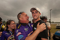 May 1, 2011; Baytown, TX, USA: NHRA pro stock driver Vincent Nobile (right) cries as he celebrates with father John Nobile after winning the Spring Nationals at Royal Purple Raceway. Mandatory Credit: Mark J. Rebilas-