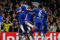 Willian of Chelsea celebrates scoring his team's second goal against Dynamo Kyiv to make it 2-1 with team mates during the UEFA Champions League Group match between Chelsea and Dynamo Kyiv at Stamford Bridge, London, England on 4 November 2015. Photo by David Horn.