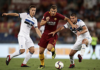 Calcio, Serie A: Roma - Atalanta, Stadio Olimpico, 27 agosto, 2018.<br /> Roma's Edin Dzeko (c) in action with Atalanta's Berat Djimsiti (r) and Mario Pasalic (l) during the Italian Serie A football match between Roma and Atalanta at Roma's Stadio Olimpico, August 27, 2018.<br /> UPDATE IMAGES PRESS/Isabella Bonotto