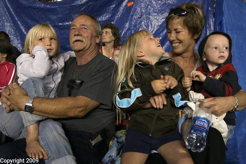 Grandparents Ron and Diana Van Diest of Custer, watch Kaitlyn Neff, 7, left, and Reuben Neff, 2, right, during the demoltion derby at the NW Washington Fair. In the center is Regan Neff, 5. Their mom, Wendy, not pictured, phone number is 366-0127. NW Washington Fair. August 17, 2009 PHOTOS BY MERYL SCHENKER