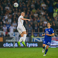 Luke Ayling of Leeds United wins a header from Craig Bryson of Cardiff City during the Sky Bet Championship match between Cardiff City and Leeds United at the Cardiff City Stadium, Cardiff, Wales on 26 September 2017. Photo by Mark  Hawkins / PRiME Media Images.