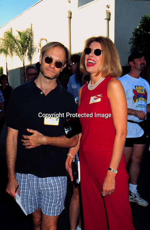 "©KATHY HUTCHINS/HUTCHINS.9/29/97 "" APLA AIDS WALK LOS ANGELES "".DAVID HYDE PIERCE & CHRISTINE BARANSKI"