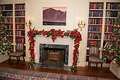 "The 2018 White House Christmas decorations, with the theme ""American Treasures"" which were personally selected by first lady Melania Trump, are previewed for the press in Washington, DC on Monday, November 26, 2018. Garland on the mantel in the White House Library.  <br /> Credit: Ron Sachs / CNP"