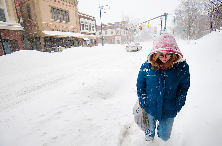 TORRINGTON,  CT-020215JS02- Rebecca Mcgonigal fights her way through the snow on Main Street in Torrington on her way to visit a friends house during Monday's snowfall. Nearly a foot of snow fell in some parts of the area. <br /> Jim Shannon Republican-American