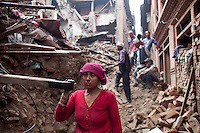 Women are helping for relief in the rubble following the earthquake in Bhaktapur, near Kathmandu, Nepal. May 7, 2015
