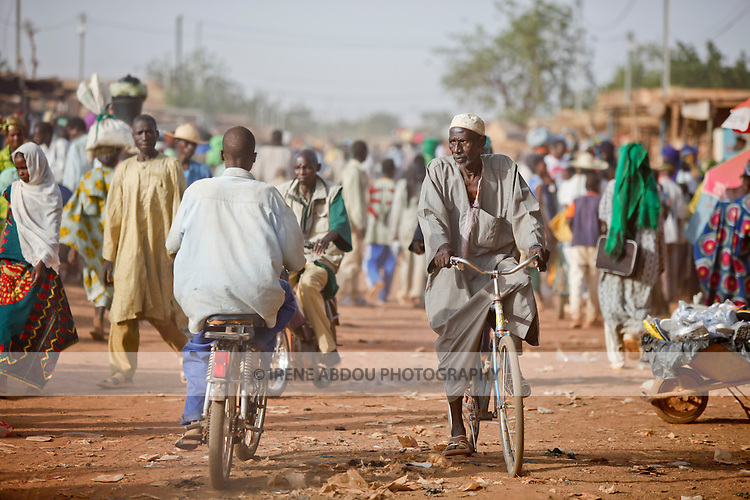"In West Africa, certain villages have markets that ""assemble"" at regular intervals, such as weekly or every three days.  People from villages around the region converge on the town of Djibo in northern Burkina Faso every Wednesday to buy and sell food, livestock, and other goods and services."