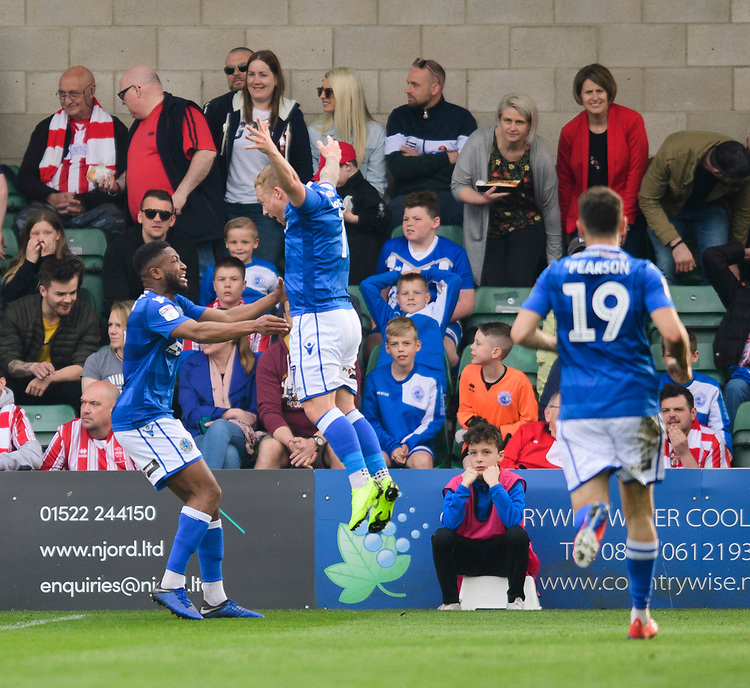 Macclesfield Town's Scott Wilson, left, celebrates scoring the opening goal with team-mate Elliott Durrell<br /> <br /> Photographer Chris Vaughan/CameraSport<br /> <br /> The EFL Sky Bet League Two - Lincoln City v Macclesfield Town - Saturday 30th March 2019 - Sincil Bank - Lincoln<br /> <br /> World Copyright © 2019 CameraSport. All rights reserved. 43 Linden Ave. Countesthorpe. Leicester. England. LE8 5PG - Tel: +44 (0) 116 277 4147 - admin@camerasport.com - www.camerasport.com