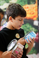 NWA Democrat-Gazette/DAVID GOTTSCHALK Jackson Wallace, a fifth grade student at Harp Elementary School, examines a milk carton Friday, September 11, 2015 along with other students as they participate in the To The Market station of the Farm and You agricultural program at the school in Springdale. Students at the school rotated through nine stations with different interactive activities about the importance of food, farms and good health.