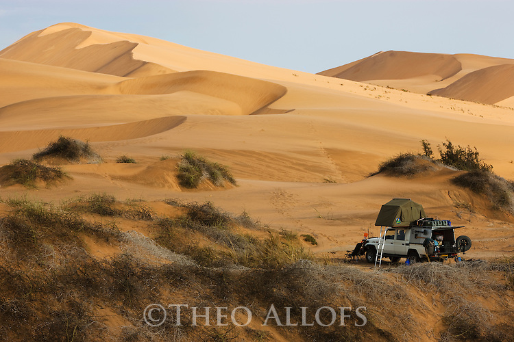 Namibia, Namib Desert, Dorob National Park, camping in sand dunes with4x4 vehicle and roof top tent