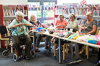 Elderly women selling their knitting wares during Queen Elizabeth II birthday celebrations at the Barking Community Centre in East London.