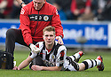 ST MIRREN'S MARC MCAUSLAND GETS TREATMENT FOR A KNOCK TO THE FACE