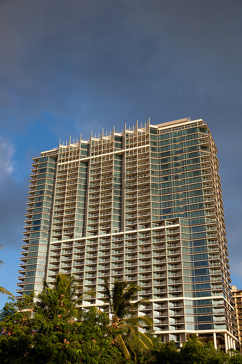 Trump International Hotel Waikiki Beachwalk is a luxury resort property located in downtown Honolulu, just one block off of the popular Waikiki Beach.  The units all have complete kitchens and luxurious amenities with stunning views of the Pacific Ocean.  The hotel also offers spa services and it's signature spa bath amenities.  The view of the property from the park adjacent to the hotel.
