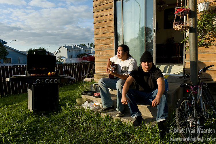 Simon Reece (right) and Gitz Crazyboy sit on the back step in Fort McMurray. Both young men have dedicated their lives to making a better place in this world for future generations.