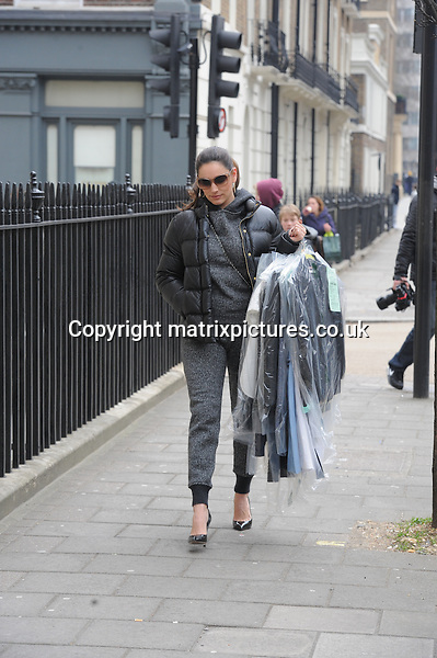 NON EXCLUSIVE  PICTURE: MATRIXPICTURES.CO.UK.PLEASE CREDIT ALL USES..WORLD RIGHTS..English model and media personality Kelly Brook is spotted wearing an odd grey hooded-tracksuit and gore tex winter jacket while picking up her dry cleaning in London today...MARCH 27th 2013..REF: LTN 132024