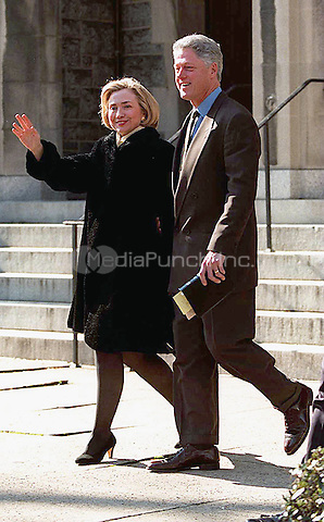United States President Bill Clinton and first lady Hillary Rodham Clinton wave to photographers, January 25, 1998 as they depart Sunday services at the United Methodist Foundry Church in Washington, DC.<br /> Credit: CNP/MediaPunch